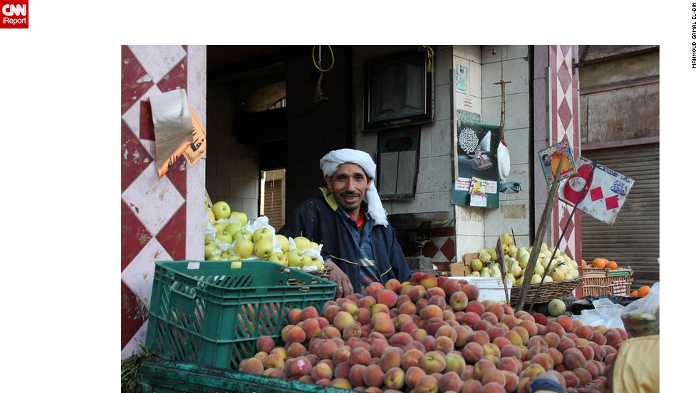 A market trader at his fruit stall in Cairo. Many ordinary Egyptians are suffering from high inflation pushing up the price of consumer goods and food. Picture from iReporter Mahmoud Gamal El-Din.