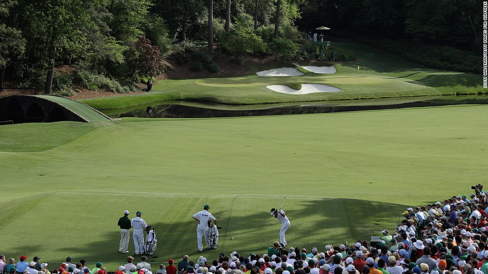 "Here Bubba Watson hits his tee shot on the 12th hole -- known as ""Golden Bell"" -- on his way to victory at the 2012 Masters, which was his first major title."
