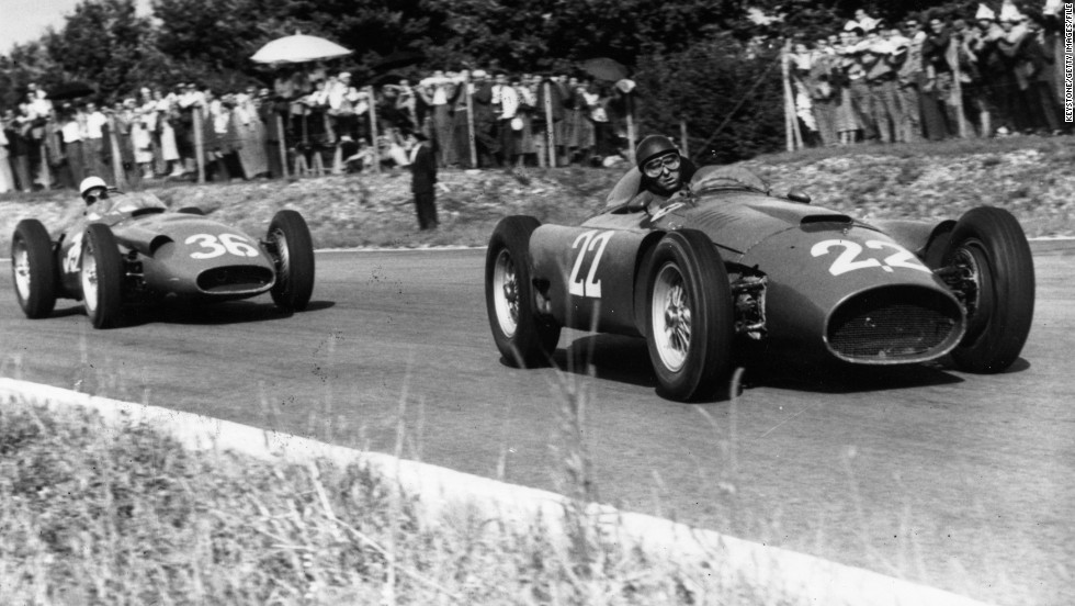 "Moss (left) trails behind Fangio at the Italian Grand Prix in 1956. ""I'm glad I raced when I did and not now because the pleasure was so much more then and the racing certainly was purer,"" Moss says."