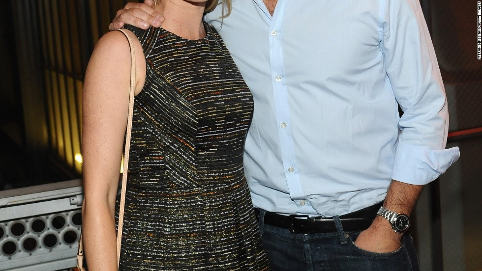 Amy Smart and Carter Oosterhouse attend Coach's Evening of Cocktails and Shopping benefit in Santa Monica, California.