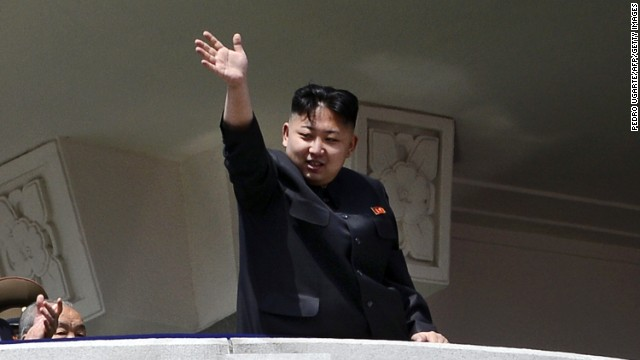 North Korea's leader Kim Jong-Un waves at the end of a major military parade to mark 100 years since the birth of the country's founder and his grandfather, Kim Il-Sung, in Pyongyang on April 15, 2012. The commemorations came just two days after a satellite launch timed to mark the centenary fizzled out embarrassingly when the rocket apparently exploded within minutes of blastoff and plunged into the sea. AFP PHOTO / PEDRO UGARTE (Photo credit should read PEDRO UGARTE/AFP/Getty Images)