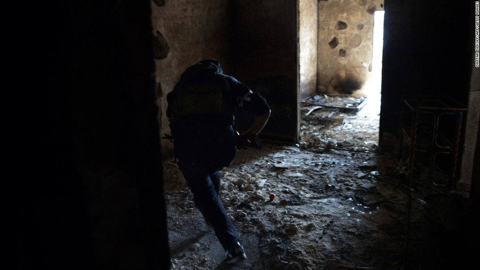 A rebel runs to avoid sniper fire from Syrian government forces in Aleppo on April 11.