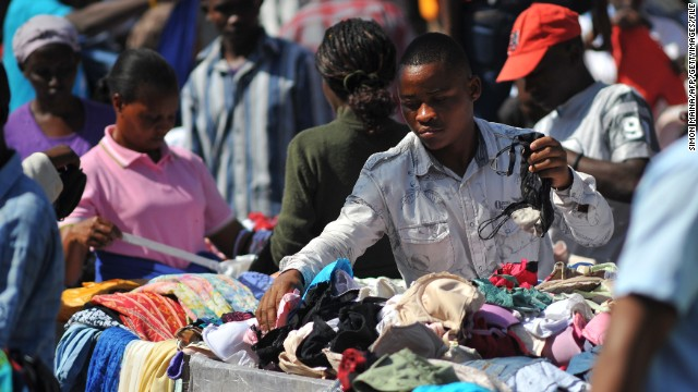 A Kenyan vendor sells second-hand clothes (locally known as mitumba) at the Gikomba open-air market on June 25, 2012, in Nairobi. Local dealers welcomed Kenya's Finance Minister Njeru Githai's move to lower import duty on ' Mitumba' in this year's budget read two weeks ago. However, trade experts say the reduction on import duty, will put over 270,000 jobs in the cotton industry at risk and lives of farmers as well.