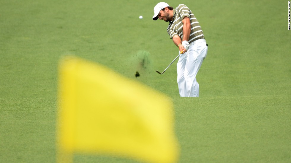 Francesco Molinari of Italy hits the ball on the second hole.