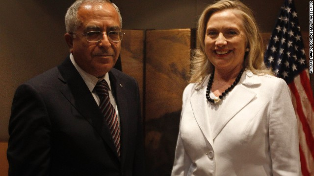 Palestinian Prime Minister Salam Fayyad and former U.S. Secretary of State Hillary Clinton in Jerusalem in July 2012.