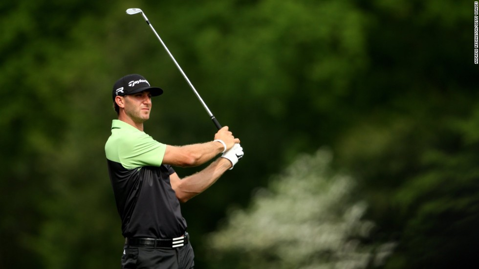 "Dustin Johnson of the U.S. watches his tee shot on the 12th hole during the first round of the 2013 Masters Tournament on Thursday, April 11, at  Augusta National Golf Club in Georgia. Click through to see all the shots from the first day and <a href=""http://www.cnn.com/2013/04/10/golf/gallery/masters-par-3/index.html"" target=""_blank"">look back at the Par 3 Contest</a>."