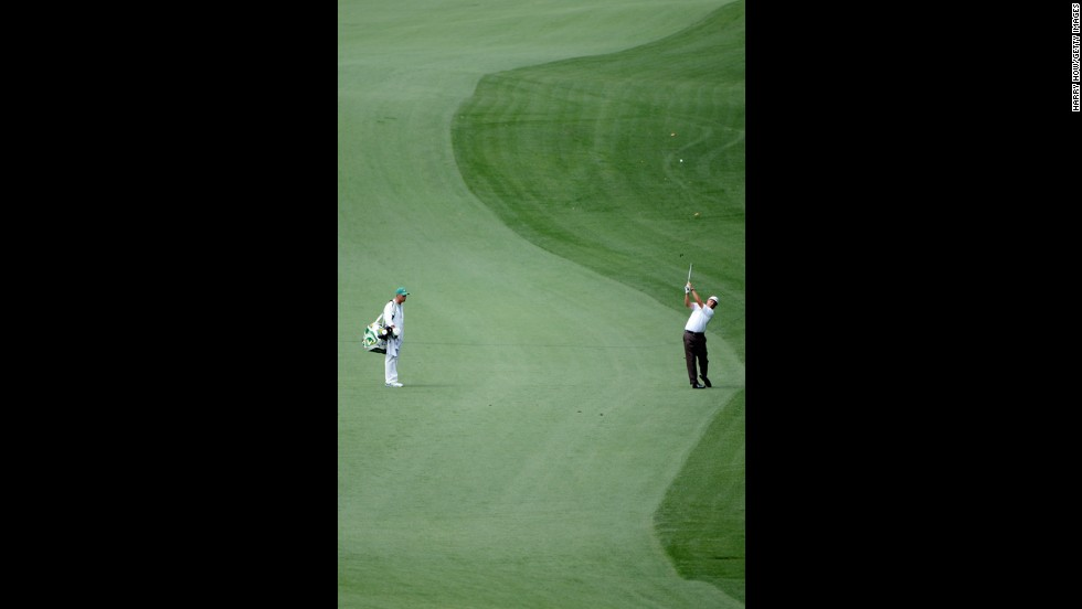 Phil Mickelson of the U.S. hits his second shot on the 10th hole.