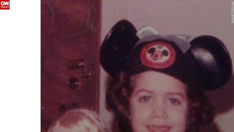 "Allison Dasso of Chicago runs the fan site <a href=""http://waltdatedworld.bravepages.com/"" target=""_blank"">Walt Dated World</a>, and took her first trip to Walt Disney World at age 4 in 1978. That first time, she didn't bring her <a href=""http://ireport.cnn.com/docs/DOC-954859"">mouse ears</a> from home. ""I ended up buying a Donald Duck cap with a beak that squeaked. To this day when I look at the pictures, it just doesn't seem right when I see a duck on my head instead of a mouse. It felt like I was cheating on Mickey."" She more than made up for it on future trips, wearing her many different mouse ears with pride."