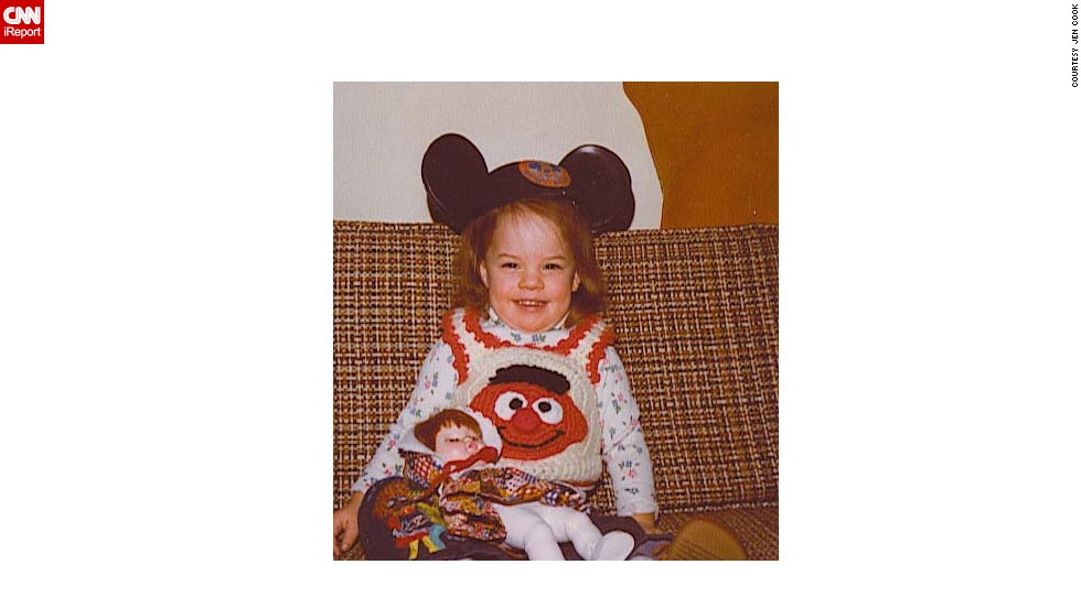 "Jen Cook grew up in Northbrook, Illinois, loving <a href=""http://ireport.cnn.com/docs/DOC-953658"">Disney and Mickey Mouse</a>. ""It was my first stuffed animal and I still have him.  He's in rough shape but was always with me ... in the hospital, at college and even now as a parent,"" she says."