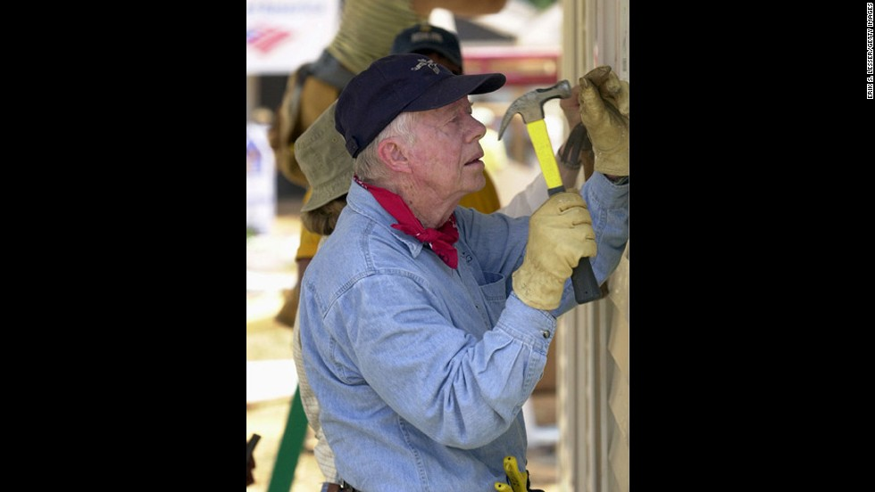 President Jimmy Carter works on a Habitat for Humanity home in LaGrange, Georgia, in 2003.