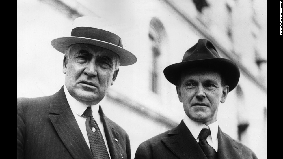 President Warren G. Harding, left, sports a straw boater, while Vice President Calvin Coolidge chooses a fedora, in 1922.
