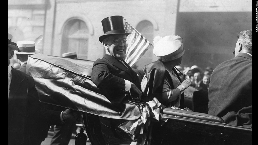 In 1920 in New York, the occasion calls for a top hat for President Woodrow Wilson.