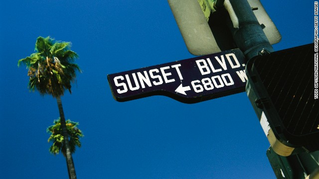 Hollywood, Los Angeles, California. Looking up at Sunset Boulevard sign with palm tree in background.  (Photo by Todd Gipstein/National Geographic/Getty Images)