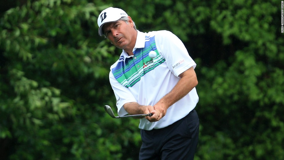 Fred Couples of the United States hits a shot on the fifth hole.