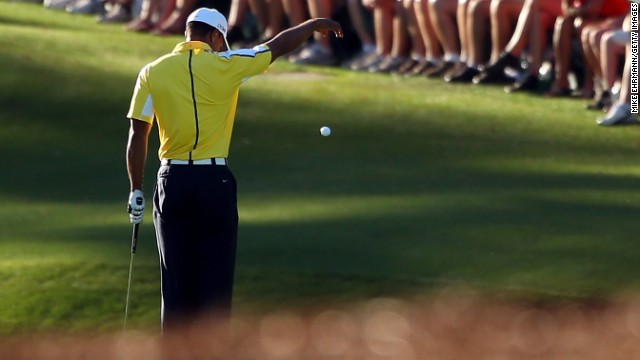 AUGUSTA, GA - APRIL 12:  Tiger Woods of the United States drops his ball after he hits it into the water on the 15th hole during the second round of the 2013 Masters Tournament at Augusta National Golf Club on April 12, 2013 in Augusta, Georgia.  (Photo by Mike Ehrmann/Getty Images)