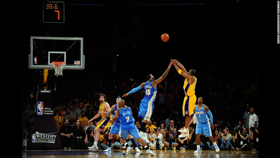 Bryant shoots a jumper over Carmelo Anthony, No. 15 of the Denver Nuggets, in the fourth quarter of game one of the Western Conference Finals during the 2009 NBA Playoffs at Staples Center on May 19, 2009. The Lakers defeated the Nuggets 105-103.