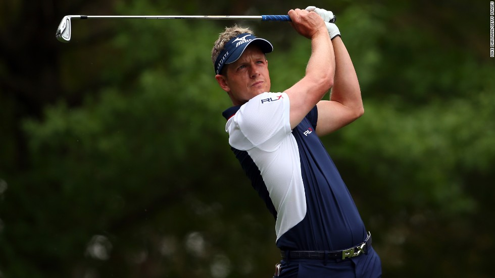Luke Donald of England hits a shot on the fourth hole.