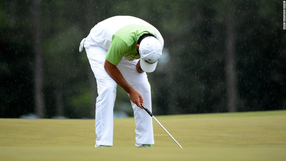 Jason Day of Australia reacts after missing a birdie putt on the 18th green.