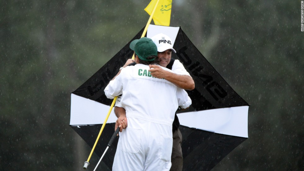 Angel Cabrera of Argentina hugs caddie Angel Cabrera Jr. after Cabrera makes a birdie putt on the 18th hole to force the playoff with Adam Scott of Australia.