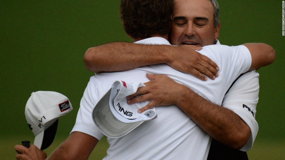 Adam Scott, left, hugs Angel Cabrera after winning.