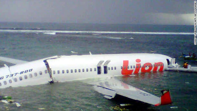 Plane overshot runway, ended up in water