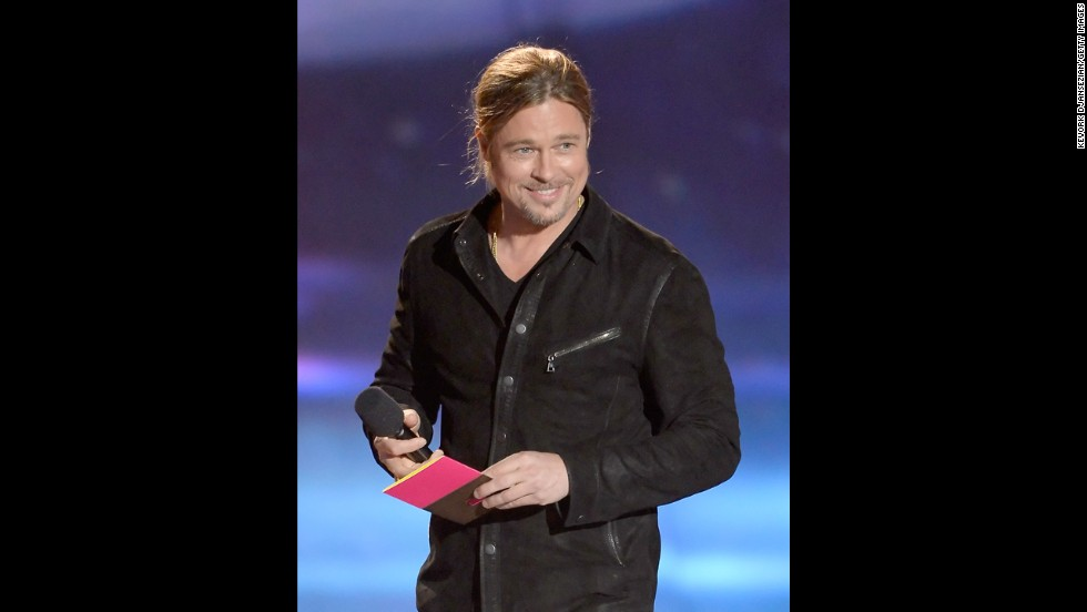 "Brad Pitt presents the movie of the year award to ""The Avengers."""