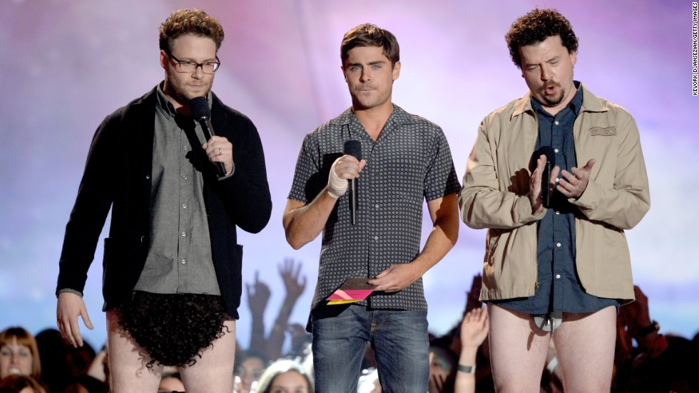 Seth Rogen, left, and Danny McBride, right, present the award for Best Shirtless Performance, making Zac Efron supremely uncomfortable in the process.