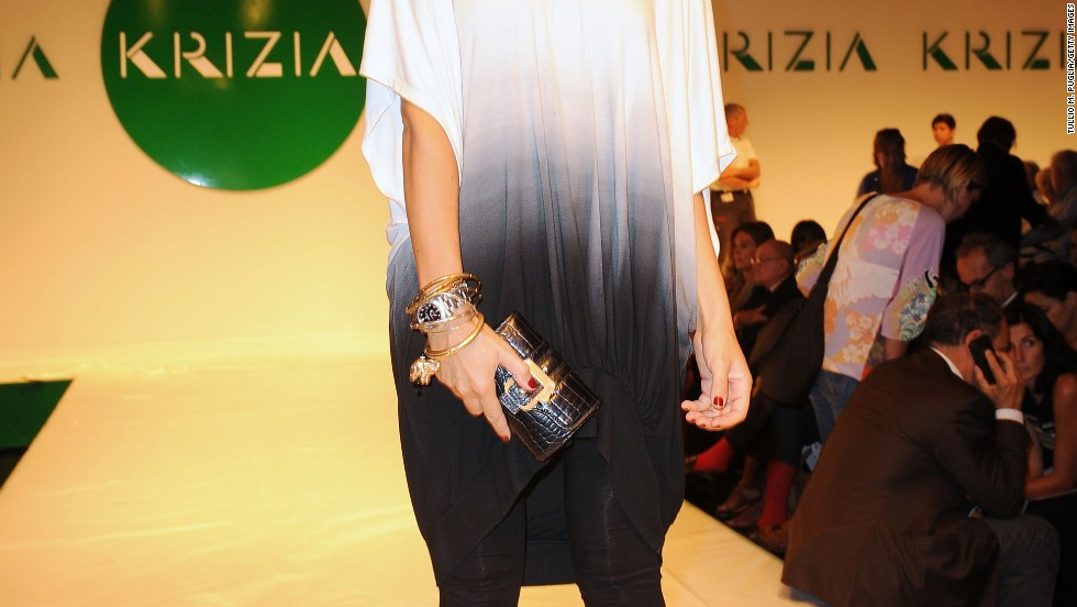 Francesca Senette wears leggings with a loose tunic at a Krizia fashion show.