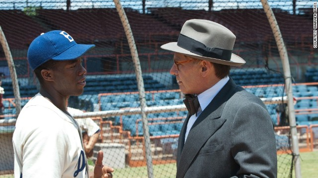 "Chadwick Boseman stars as Jackie Robinson and Harrison Ford stars as Branch Rickey in the film ""42."""