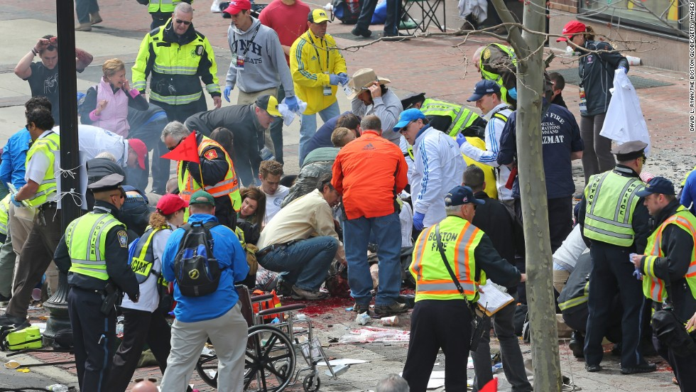 Police and emergency crews tend to victims.