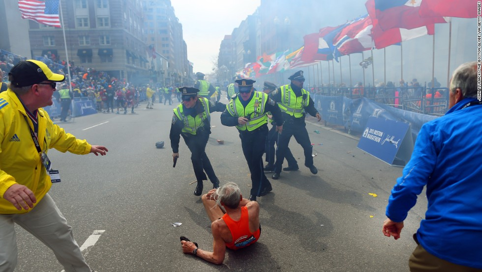 Tlumacki captured the moment right after the first explosion knocked down 78-year-old runner Bill Iffrig at the finish line. Iffrig got up a few minutes later and finished the race.