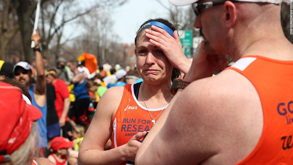 A runner reacts near Kenmore Square after the explosions.
