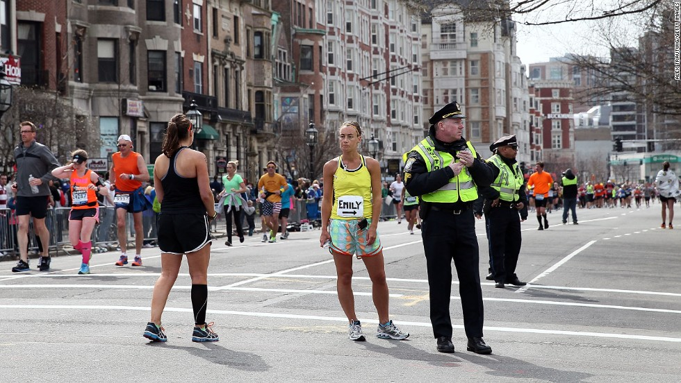 Police and runners stand near Kenmore Square after the attack.