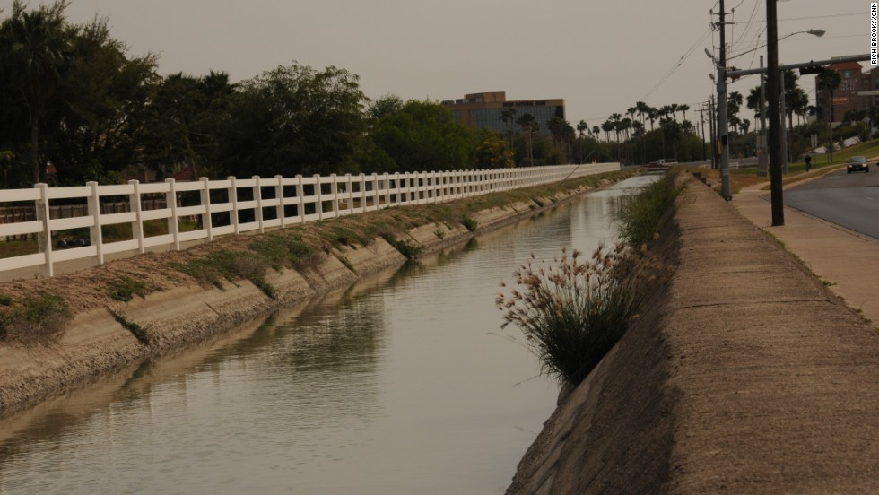 "Five days after she disappeared, police found Garza's body face down in this McAllen canal. An autopsy report states that her body showed evidence of ""recent trauma, sexual intercourse"" and ""trauma to the head."" According to the report, ""evidence of strangulation could not be found, but suffocation could have been carried out by placing a cloth over the mouth and nose."" ""The subject was dead when placed into the canal,"" the report said."