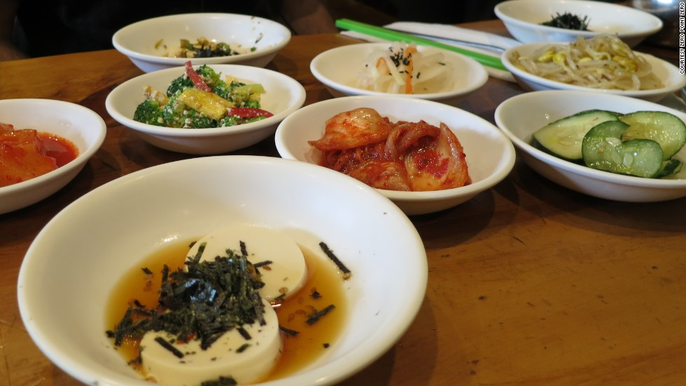 Ban chan, including kimchi, pickled vegetables, bean sprouts and silken tofu at Beverly Soon Tofu Restaurant.