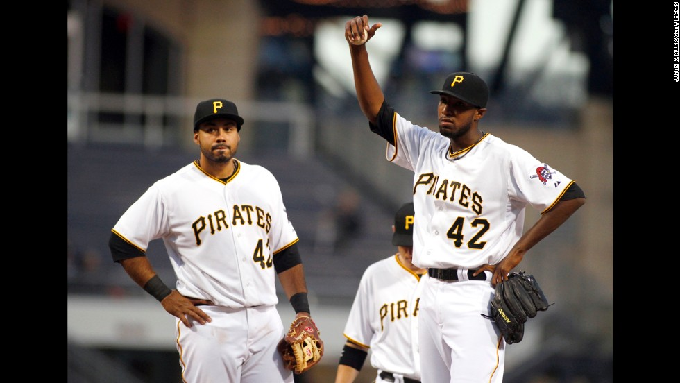 James McDonald, right, of the Pittsburgh Pirates is pulled from the game in the second inning as teammate Pedro Alvarez stands by his side at PNC Park in Pittsburgh.