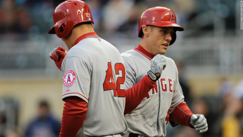 Mike Trout, left, of the Los Angeles Angels of Anaheim congratulates teammate Peter Bourjos on a solo home run against the Minnesota Twins at Target Field in Minneapolis.