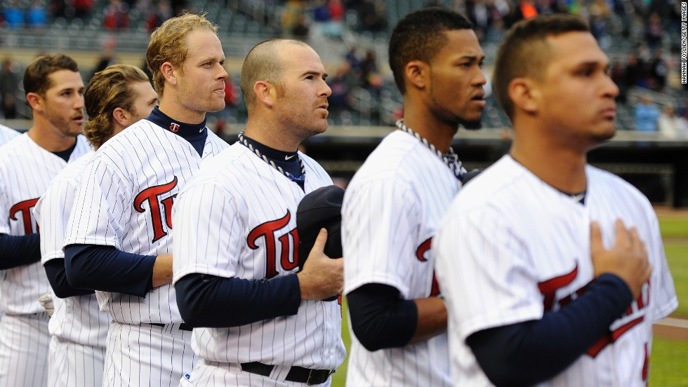 The Minnesota Twins stand during the national anthem before a baseball game in Minneapolis on April 15, 2013.