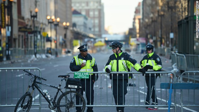 Boston police officer man barriers closing off Boylston Streen on April 16.