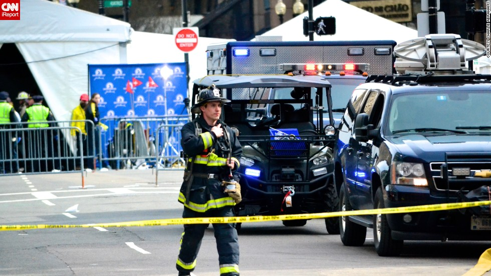 "<a href=""http://ireport.cnn.com/docs/DOC-957445"">iReporter Charlie Abrahams</a>, 47, had been shooting photos at mile 11 of the race when he headed back toward Boston and was greeted by sirens. He went over to Copley Square, close to where he lives, and captured photos of the first responders."