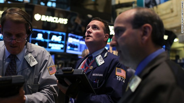 Traders work on the floor of the New York Stock Exchange on April 15, 2013 in New York City. Following disappointing news on economic growth in China, stocks fell sharply Monday morning with the Dow Jones industrial average down 95 points in morning trading.