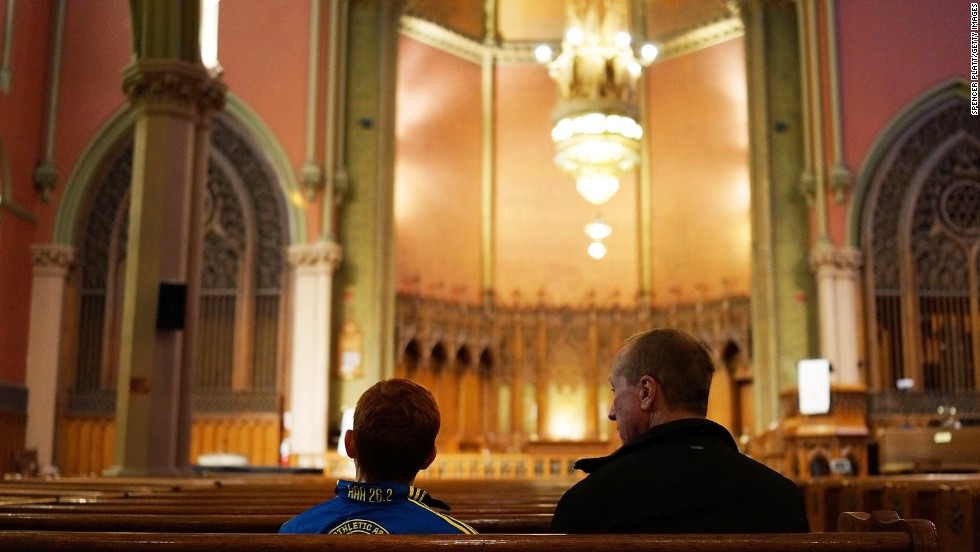 "The city was quiet <a href=""http://www.cnn.com/2013/04/16/us/gallery/boston-aftermath/index.html"">the day after the tragedy.</a> Here, a young runner, left, sits in a church near the scene of the attack."