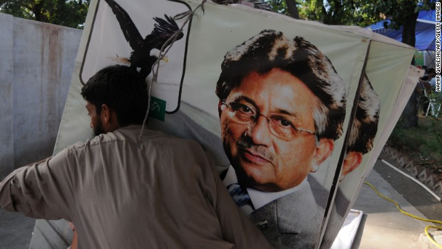 A supporter of former Pakistani president Pervez Musharraf places banners at the party office in Islamabad on April 16, 2013.