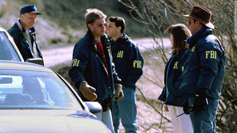 "Three people were killed and 23 others were wounded after a string of mail bombings carried out by Ted Kaczynski, aka ""The Unabomber,"" from 1978 to 1995. Here, FBI agents guard the entrance to Kaczynski's property in Lincoln, Montana, on April 5, 1996. In May 1998, Kaczynski received eight life sentences for his crimes."