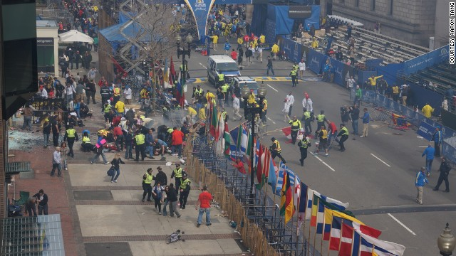 """Aaron Tang witnessed the Boston Marathon bombing from his office, which is a half block from the finish line. """" Big blast of fire, and smoke, but it all vanished so fast and not much left to see minus lots of shattered glass,"""" he said on his Flickr album."""