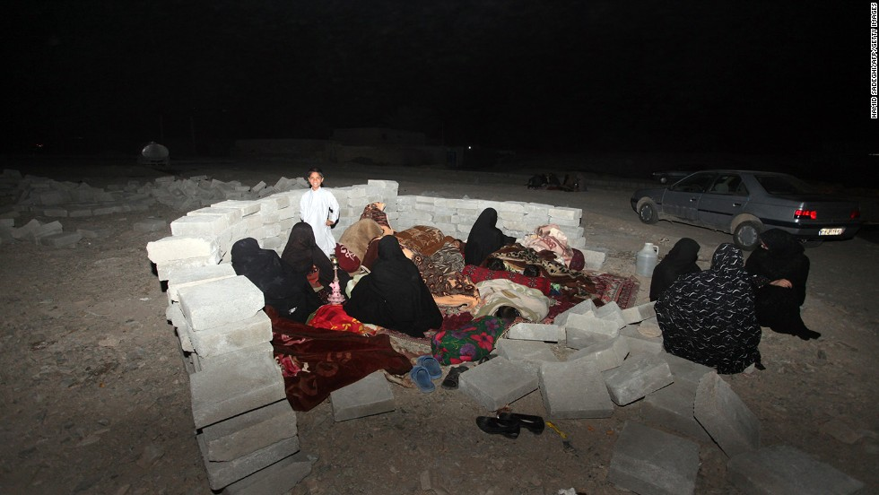 Iranian residents take shelter in a field after the earthquake in the city of Saravan in southeastern Iran on Tuesday, April 16.