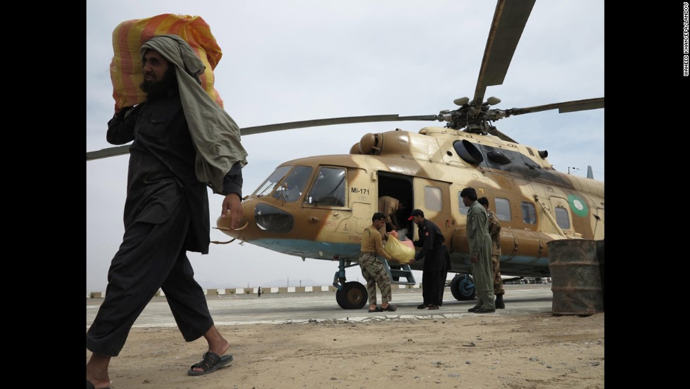 Pakistani army officials unload relief goods Wednesday in Mashkell.