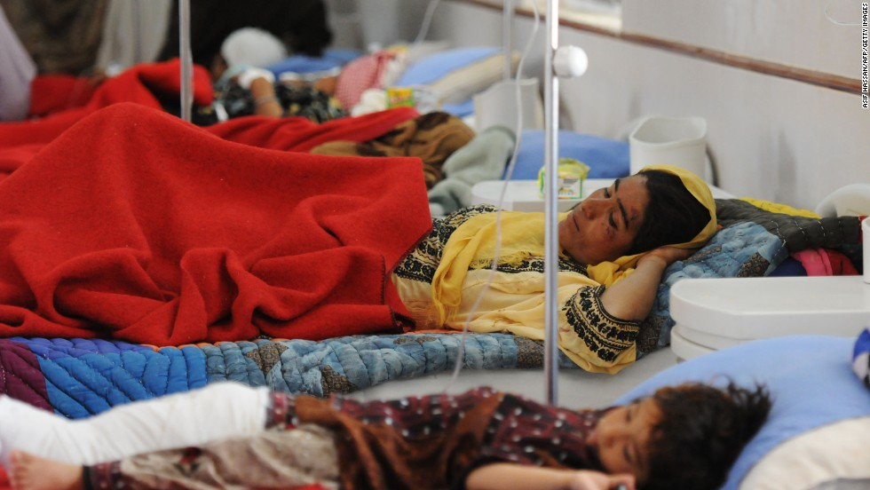 Earthquake victims lie on beds at a military hospital in Quetta, Pakistan, on Wednesday.