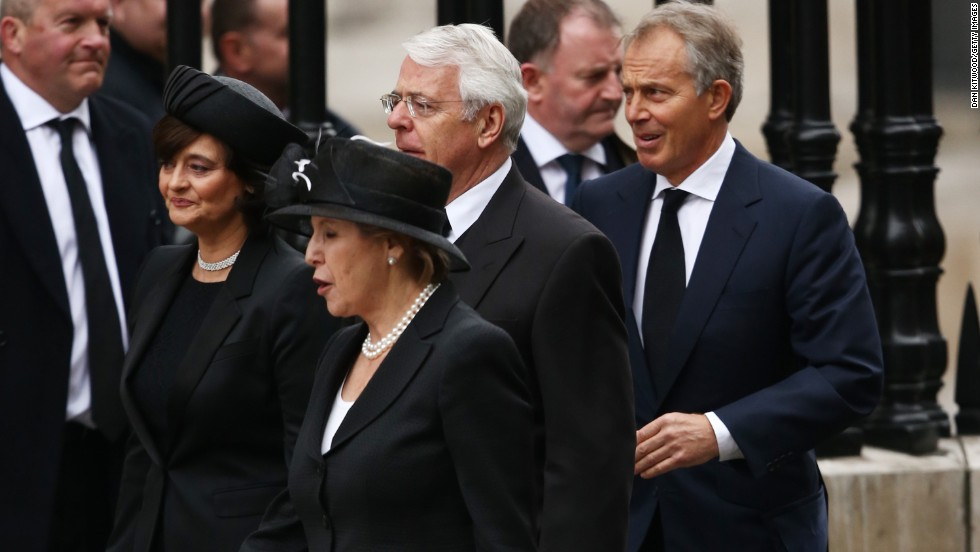 Former Prime Ministers John Major, center, and Tony Blair attend the funeral with wives Norma Major and Cherie Blair, left.