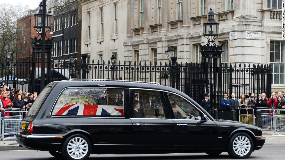 The hearse makes its way past Downing Street in London.